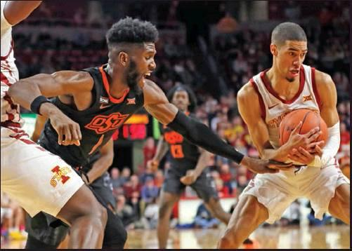 IOWA STATE guard Tyrese Haliburton, right, steals the ball from Oklahoma State guard Jonathan Laurent, left, during a basketball game Tuesday in Ames, Iowa. Iowa State won 89-82. (AP Photo)