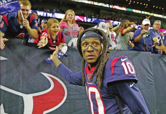 HOUSTON TEXAN wide receiver DeAndre Hopkins celebrates with fans after an NFL wild-card playoff game against the Buffalo Bills in Houston. The Arizona Cardinals have acquired three-time All-Pro receiver Hopkins in a trade that sent running back David Johnson and draft picks to the Houston Texans, (AP Photo)