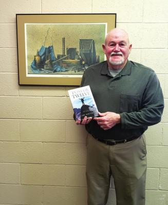 Author Gary Watters with his new book, The Power of Twelve, available now at Brace Books. Photo by Darlene Engelking