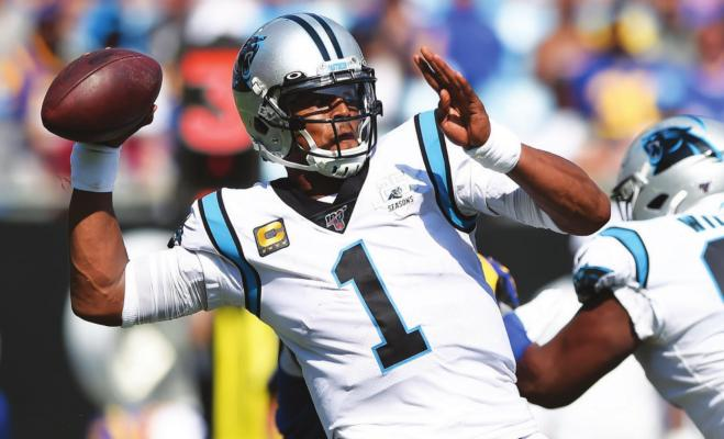 IN THIS SEPT. 9, 2019, file photo, Carolina Panthers quarterback Cam Newton looks for a receiver during the team's NFL football game against the Los Angeles Rams during the second half in Charlotte, N.C. The New England Patriots have reached an agreement with free-agent quarterback Newton, bringing in the 2015 NFL Most Valuable Player to help the team move on from three-time MVP Tom Brady, a person with knowledge of the deal told The Associated Press. (AP Photo/Mike McCarn, File)