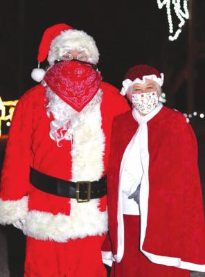 Standing in for Santa and Mrs. Claus were Steve Mills and Marilyn Leaming.