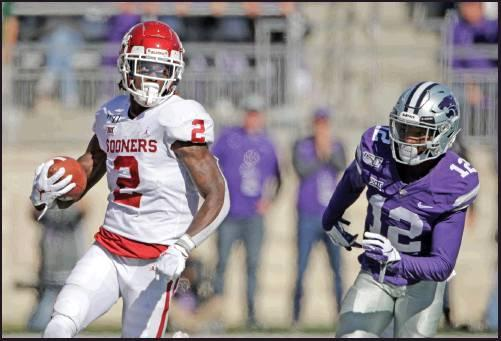 OKLAHOMA WIDE receiver CeeDee Lamb (2) gets past Kansas State defensive back AJ Parker (12) to run the ball during a game Saturday in Manhattan, Kan. The Sooners lost that game but had a week off to prepare for this week's game with Iowa State. (AP Photo)