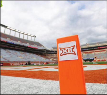 IN THIS OCT. 7, 2017, file photo, a Big 12 pylon marks the end zone at Darrell K Royal Texas Memorial Stadium before an NCAA college football game between Texas and Kansas State in Austin, Texas. Big 12 schools have agreed to play one nonconference football game this year to go along with their nine league contests as plans for the pandemic-altered season continued to fall into place. (AP Photo/Eric Gay, File)