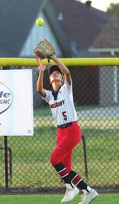 CATCHING A fly ball up against the fence is Ponca City left fielder Margaret Blackstar (5) during Monday's game against Owasso at the West Middle School softball field. Owasso won the game 11-1. This photo was provided by Larry Williams.