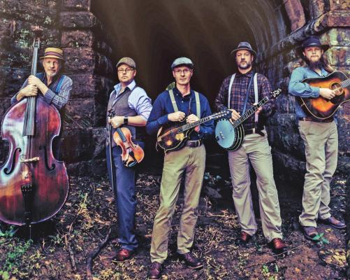 Pictured from left to right are members of the band, Appalachian Road Show, Todd Phillips, upright bassist, Jim Vancleve, fiddler and producer, Darrell Webb, singer and mandolinist, Barry Abernathy, banjoist and lead singer and Zeb Snyder, guitarist. Appalachian Road Show will be performing live at Stagecoach BBQ in Newkirk on Sunday, Sept. 20th at 5 p.m. (Photo credit goes to Micah Schweinsberg).