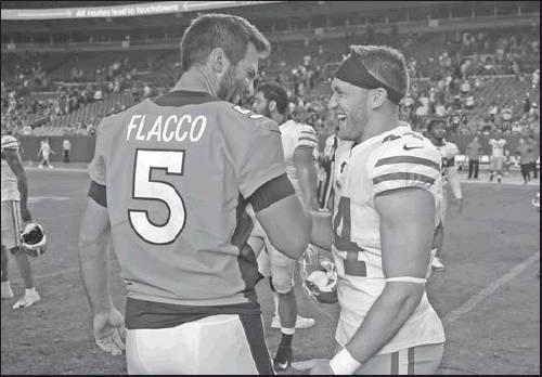 DENVER BRONCOS quarterback Joe Flacco (5) greets San Francisco 49ers fullback Kyle Juszczyk (44) after an NFL preseason game Monday in Denver. The 49ers won 24-15. (AP Photo)
