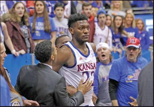 KANSAS FORWARD Silvio De Sousa (22) walks out of the crowd after a brawl during the second half of an NCAA college basketball game against Kansas State in Lawrence, Kan., Tuesday. DeSousa was one of the players suspended by the Big 12 for participating in the fracas, (AP Photo)