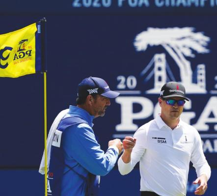 ZACH JOHNSON greets his caddie Brian Smith on the ninth green after their first round of the PGA Championship golf tournament at TPC Harding Park Thursday, Aug. 6, 2020, in San Francisco. (AP Photo/Charlie Riedel)
