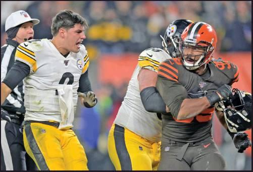 CLEVELAND BROWNS defensive end Myles Garrett (95) reacts after swinging a helmet at Pittsburgh Steelers quarterback Mason Rudolph (2) in the fourth quarter of an NF gameThursday, in Cleveland. The Browns won 21-7 but Garrett was banned from playing the rest of the season.. (AP Photo)