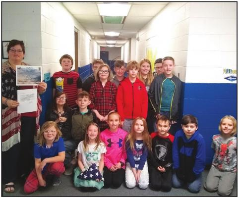 MRS. LORETT and her fourth grade class at Kildare School are pictured here with their letter, certificate and very special flag that was flown in a mission in Afghanistan that they received in the mail. They are pen pals with U.S. Army Sergeant Mark Harden, who is stationed overseas and is from the Ponca City area and used to be a student at Kildare School and graduated from Newkirk High School. He is also an uncle to a student in Mrs. Lorett's class.
