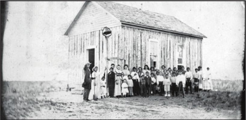 MEMBERS OF the Ottawa Tribe who eventually settled in Oklahoma gather in front of a church after their forcible removal to Kansas. Photo provided by Ottawa Tribe of Oklahoma.
