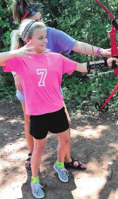 ARCHERY IS one of the many day camp activities during the three weeks of Day Camp at Camp McFadden the first three weeks of July.