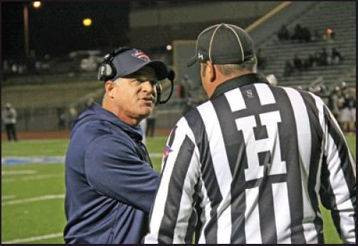 COACH SCOTT Harmon of Ponca City has a discussion with a game official during Friday's football contest at Booker T. Washington in Tulsa. The Wildcats got behind early and despite a comeback in the second half eventually lost a 34-14 decision. (News Photo by David Miller)