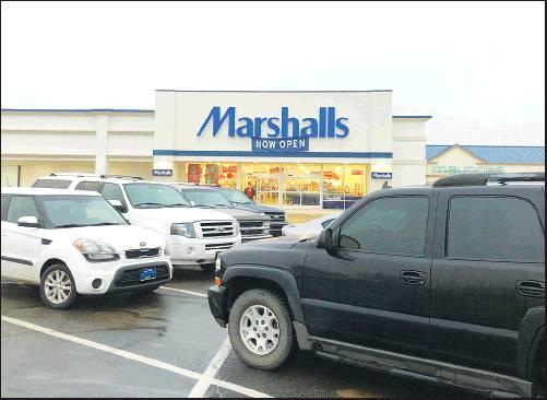 SHOPPERS TURNED out early Friday morning at the new Marshalls store in Ponca City to take advantage of the annual sales event, in spite of cold, drizzly weather. (News Photo by Mike Seals)