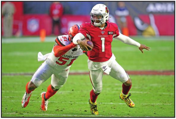 ARIZONA CARDINALS quarterback Kyler Murray (1) gets away from Cleveland Browns linebacker Mack Wilson (51) during an NFL game in Glendale, Ariz., last season. Coach Kliff Kingsbury and the Cardinals went 5-10-1 last year, but they're a popular pick to improve sharply this year. (AP Photo)