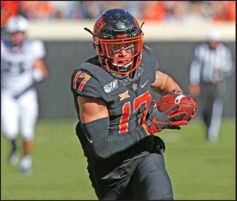 OKLAHOMA STATE wide receiver Dillon Stoner (17) runs into the end zone with a touchdown in a college football game against TCU in Stillwater Nov. 2. Stoner had a great game replacing the injured All-American Tylan Wallace. (AP Photo)