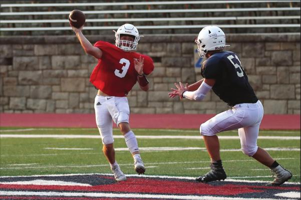 PONCA CITY quarterback Grant Harmon (3) fires a pass during Saturday's Red and Navy football scrimmage of the Ponca City Wildcats at Sullins Stadium. Saturday's scrimmage was the first opportunity for the Wildcats to scrimmage in full pads. This photo was provided by Larry Williams.