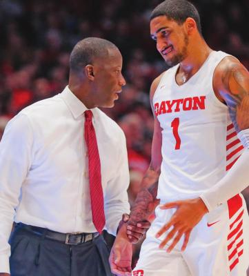 DAYTON HEAD coach Anthony Grant, left, speaks with Obi Toppin (1) during a December basketball game against Drake, in Dayton, Ohio. Toppin and Grant have claimed top honors from The Associated Press after leading the Flyers to a No. 3 final ranking. Toppin was voted the AP men's college basketball player of the year. Grant is the AP coach of the year. (AP Photo)