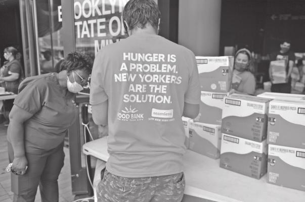 New Yorkers in need receive free produce during a Pop-Up Food pantry event hosted by Food Bank For New York City at Barclays Center on Thursday, September 10, 2020 in New York City. In addition to unemployment and homelessness, millions of Americans face food insecurity as a result of the economic downturn caused by the coronavirus pandemic. (Michael Loccisano/Getty Images for Food Bank For New York City/TNS)
