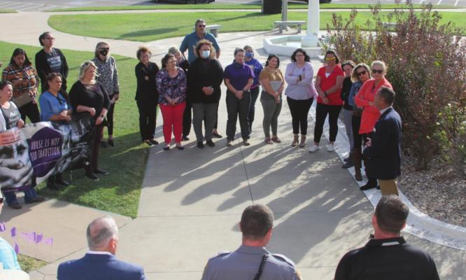 (Above) A Domestic Violence Awareness Ceremony was held on the front lawn of the Kay County Courthouse on Thursday and speeches were given by District Attorney Brian Hermanson and State Representative Ken Luttrell.