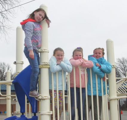 STUDENTS AT Woodlands Elementary School enjoy an outside recess since temperatures seem to be on the rise leading up to this weekend. Temperatures are expected to be in the 70s for Saturday. (News Photo by Jessica Windom)
