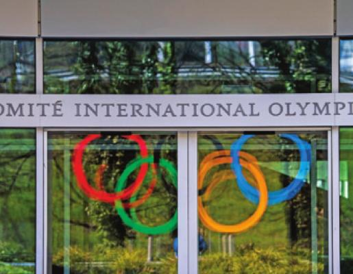 THE OLYMPIC Rings are displayed at the entrance of the IOC, International Olympic Committee headquarters during the coronavirus disease (COVID-19) outbreak in Lausanne, Switzerland Tuesday. (AP Photo)