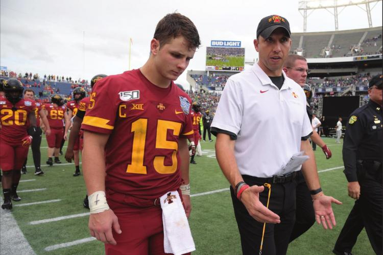 IOWA STATE head coach Matt Campbell, center, walks off the field with quarterback Brock Purdy after the Camping World Bowl NCAA college football game against Notre Dame Saturday, Dec. 28, 2019, in Orlando, Fla. Iowa State enters this season off its second-best three-year stretch in program history and with its sights set on doing something it's never done — make the Big 12 championship game. (AP Photo/Phelan M. Ebenhack, File)