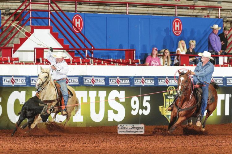 RUSS COOK of Magnolia, Texas and Ricky Oliver of Huntsville, Texas, teamed up at the last minute to score the biggest win of their recreational team roping careers in Guthrie, Oklahoma on June 23. They caught four steers fast enough during the Cactus 9.5 Over 40 competition to earn $50,000 cash during Wrangler BFI Week presented by Yeti.