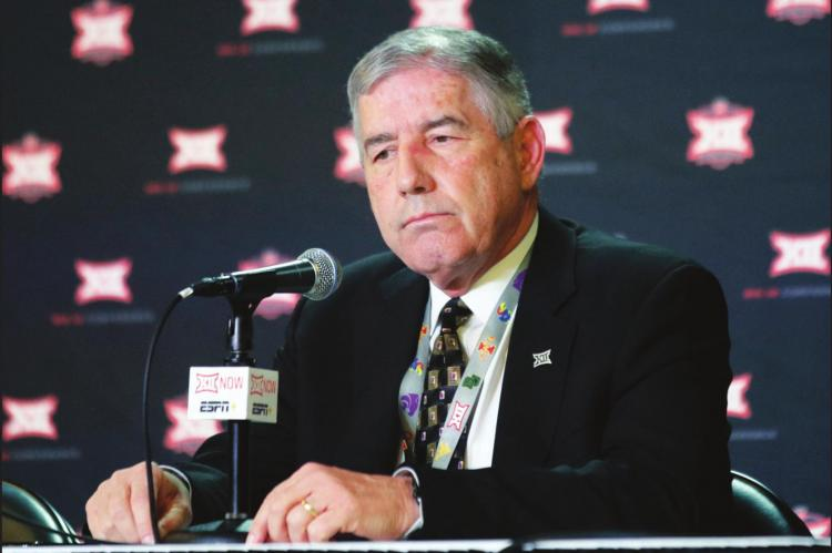 IN THIS MARCH 11, 2020, file photo, Big 12 Commissioner Bob Bowlsby announces no fans will be admitted to the rest of the Big 12 basketball tournament, in Kansas City, Kan. After the Power Five conference commissioners met Sunday, Aug. 9, 2020, to discuss mounting concern about whether a college football season can be played in a pandemic, players took to social media to urge leaders to let them play. (AP Photo/Orlin Wagner, File)