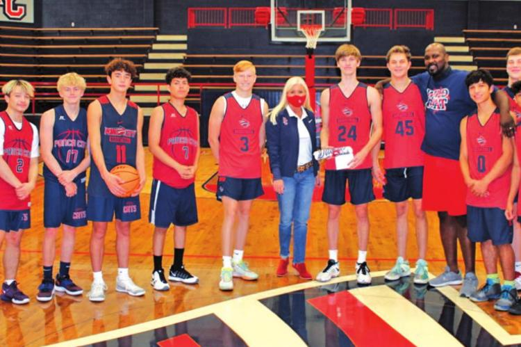 In the center of the photo is Steven Faulkner, Wildcat of the Week #4, to his right is Shelley Arrott, Superintendent. Steven is surrounded by members of the Po-Hi Varsity Boys Basketball Team, Ivan McFarlin (Po-Hi Boys Basketball Head Coach), and Ryan Shelton (PO-HI Assistant Principal).
