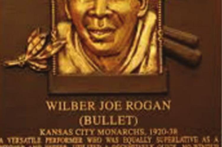 THE HALL OF Fame plaque for Bullet Joe Rogan, who was born in Oklahoma City. Bullet Joe was as good a pitcher as Satchel Paige, some said, but he could hit much better.