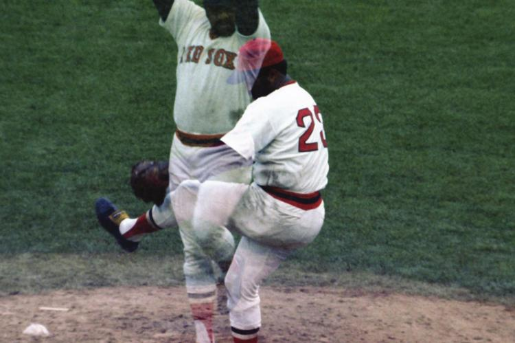 LUIS TIANT is seen in two images while pitching for the Boston Red Sox. Tiant holds the record for the most innings pitched in a season while not allowing a stolen base.