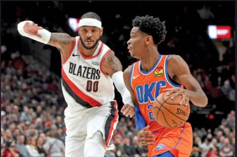 OKLAHOMA CITY Thunder guard Shai Gilgeous-Alexander, right, drives to the basket on Portland Trail Blazers forward Carmelo Anthony, left, during an NBA game in Portland, Ore., Sunday. (AP Photo)