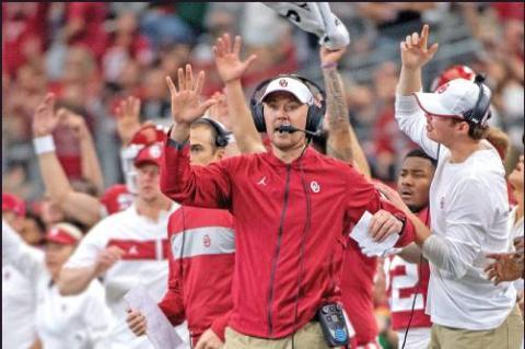 OKLAHOMA HEAD coach Lincoln Riley cheers with his players and coaches during a football game against Baylor for the Big 12 Conference championship, Saturday in Arlington, Texas. The Sooners won in overtime and will participate in the College Football Playoffs as the No. 4 seed. (AP Photo)