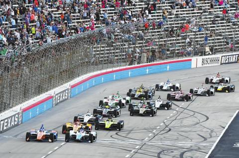 IN THIS JUNE 8, 2019, file photo, drivers jockey for position at the start of an IndyCar auto race at Texas Motor Speedway in Fort Worth, Texas. IndyCar is getting ready for an all-in-one-day season opener on the fast track in Texas, more than 2 ? months after drivers were set to roll on the streets of St. Pete. The pandemic-delayed season is now set to open Saturday, June 6, 2020. (AP Photo/Larry Papke, File)