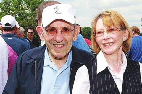 "YOGI BERRA and his wife of many years Carmen. She asked where he wanted to be buried after he died and he responded ""Surprise me."" Yogi outlived Carmen by a year."