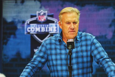 "IN THIS file photo, Denver Broncos general manager John Elway speaks during a news conference at the NFL football scouting combine in Indianapolis. NFL teams are having to rely more heavily on game film of college prospects as they prepare for the draft at a time when the COVID-19 pandemic has halted business as usual. On Tuesday, March 31, 2020 Elway said in a conference call, ""We'll just have to conclude the best we can from what we can see on the tape."" (AP Photo/Michael Conroy)"