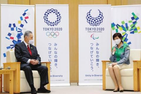 TOKYO'S NEWLY reelected Gov. Yuriko Koike, right, meets Tokyo 2020 President Yoshiro Mori at Tokyo Metropolitan Government headquarters in Tokyo Monday, July 6, 2020. Koike assured Mori that she plans to continue working with him on achieving the games, and agreed to his proposal to set up a meeting among officials from the government, Tokyo and Olympic organizers to discuss COVID-19 countermeasures. (Kyodo News via AP)