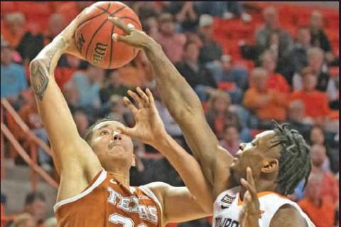 OKLAHOMA STATE guard Chris Harris Jr. (2) attempts to block a dunk by Texas forward Kamaka Hepa (33) during a college basketball game in Stillwater Wednesday. Texas won the game 76-64. (AP Photo)