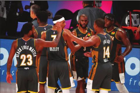 OKLAHOMA CITY Thunder forward Terrance Ferguson (23), forward Darius Bazley (7), guard Chris Paul (3), guard Devon Hall (14) and guard Luguentz Dort (5) celebrate after defeating the Washington Wizards in an NBA basketball game Sunday, Aug. 9, 2020, in Lake Buena Vista, Fla. (Kim Klement/ Pool Photo via AP)