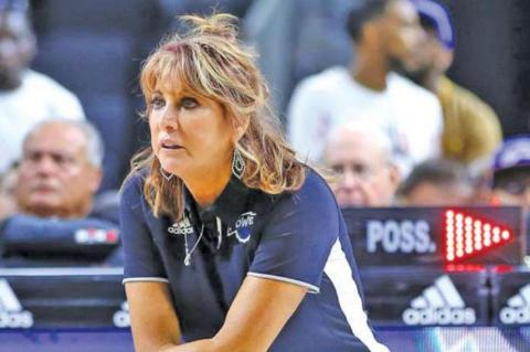 NANCY LIEBERMAN serving as an NBA assistant coach. She was the oldest woman basketball player in history, participating at age 50.