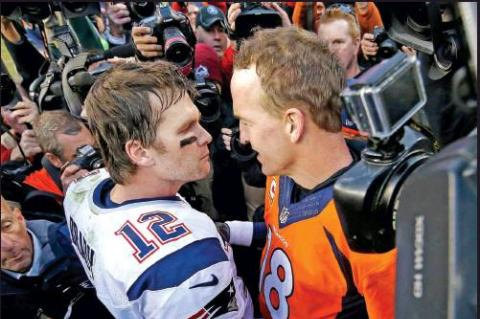 NEW ENGLAND quarterback Tom Brady (12) and Denver quarterback Peyton Manning speak to one another following the 2016 AFC Championship game between the Denver Broncos and the New England Patriots in Denver. Brady has been synonymous with the AFC championship for the last two decades. Thirteen times he played for the Lamar Hunt Trophy and nine times he won it. Peyton Manning he bested once but three other times he lost to his nemesis in the conference title game, twice in Denver.(AP Photo)