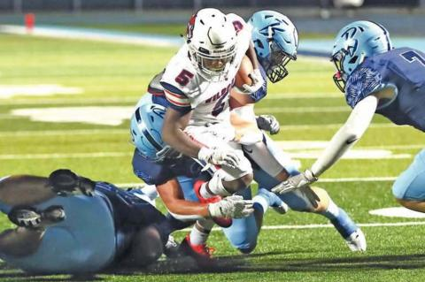 PONCA CITY running back Cameron Jackson (5) carries the ball against Bartlesville last week. The Wildcats won the game 10-7. Jackson has rushed for more than 100 yards in five consecutive games. This photo was provided by Larry Williams.