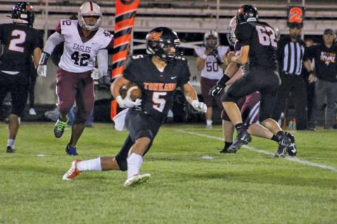 Tristan Burdock (5) runs behind block by Dominick Grein (62). (Photo by Melissa Swords)